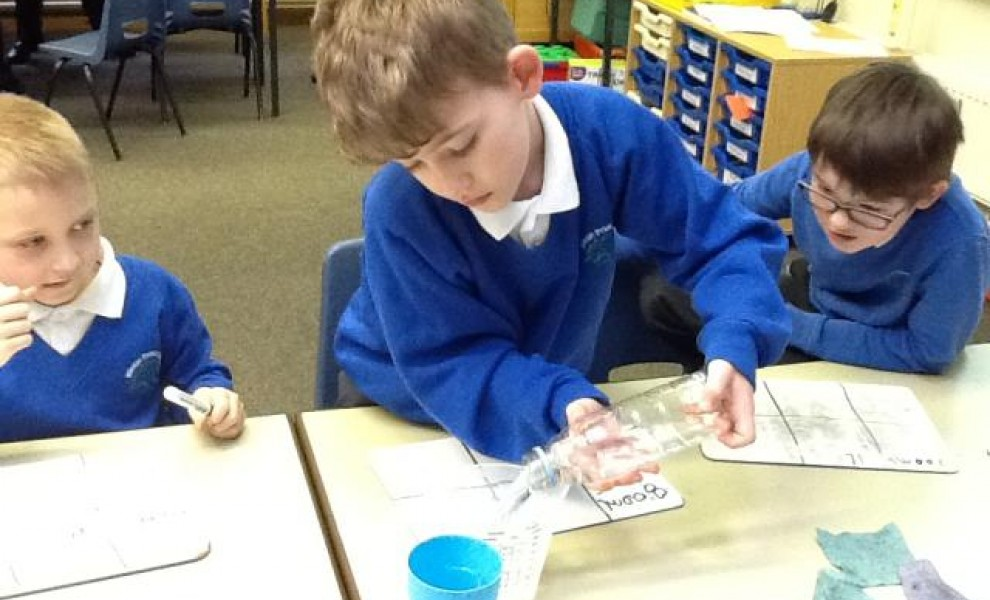 Year 3 children focused on their learning during a capacity lesson.